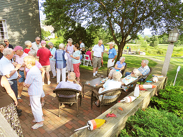 Residents enjoying appetizers on Whipple Farm patio.