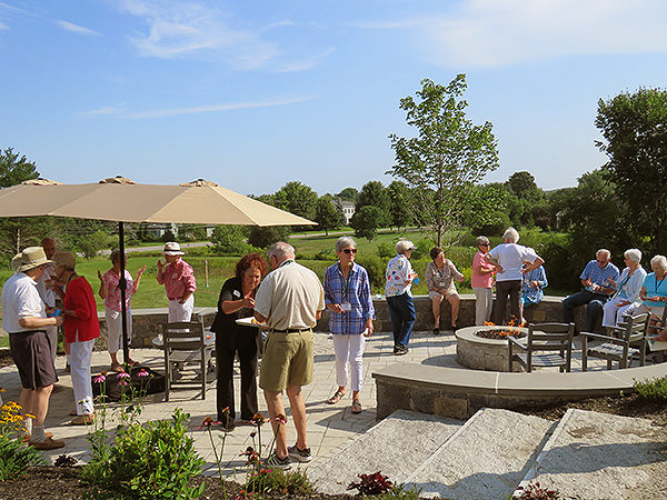 Residents enjoying Whipple Farm Overlook patio and firepit.
