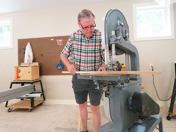 OceanView resident using scroll saw in new Workshop.