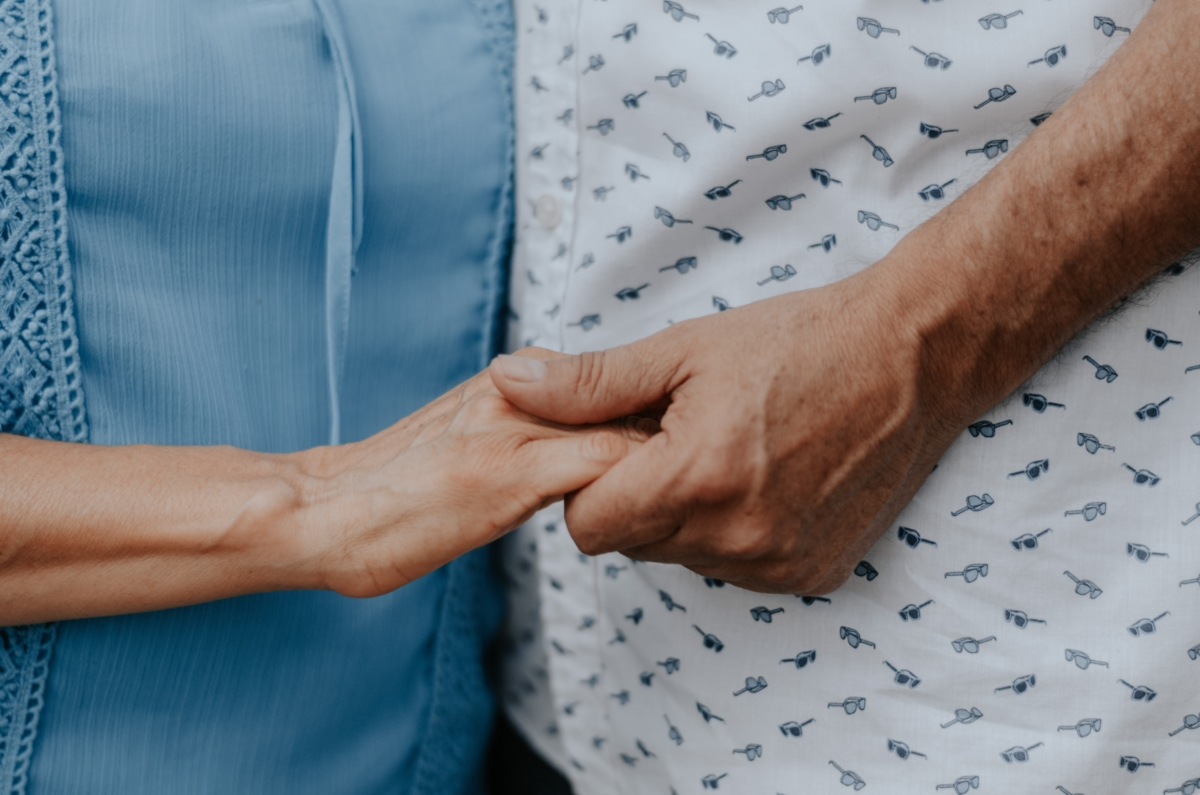 Mature Couple Holding Hands | Memory Care