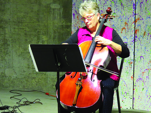 Resident Sally playing cello.