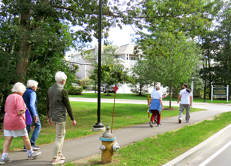 OceanView residents and staff walking on campus.