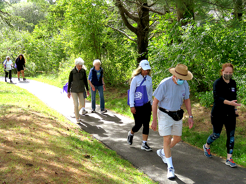 Residents and staff walking on OceanView's campus